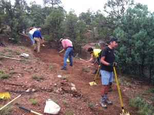 Volunteers rapidly turn an eroding gully into a smoothly sloped tread that sheds water.