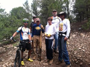 A visitor from Natal, Brazil, stops to learn about volunteer work on City trails.  Bike: Mellow Velo.  Photo: Juan Alonso.